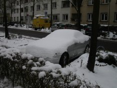 Snow on a car in Karlsruhe